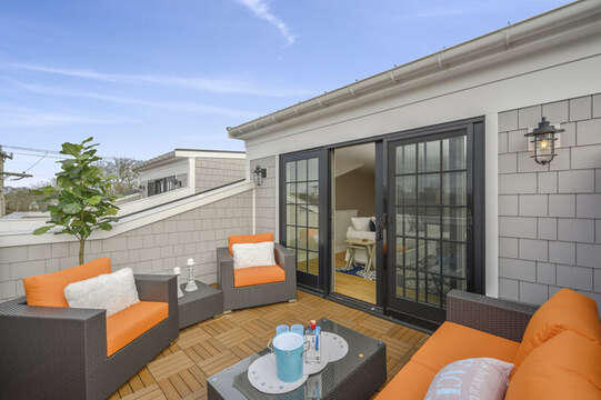 Roof Top Terrace with ample seating for relaxing after a long day on the beach, Unit 204 557 Route 28, Harwich Port, Cape Cod, New England Vacation Rentals