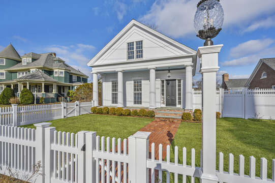The Pineapple House with fenced in front yard. 530 Route 28 Harwich Port, Cape Cod, New England Vacation Rentals