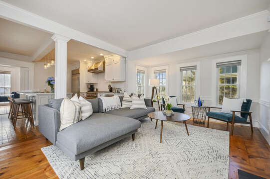 Living room with ample seating opens into the chefs kitchen with island with seating for 3.530 Route 28 Harwich Port, Cape Cod, New England Vacation Rentals
