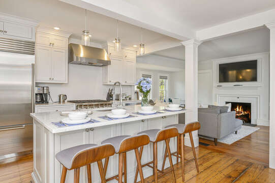 Open concept kitchen - living area with large center island with seating for 4. 530 Route 28 Harwich Port, Cape Cod, New England Vacation Rentals