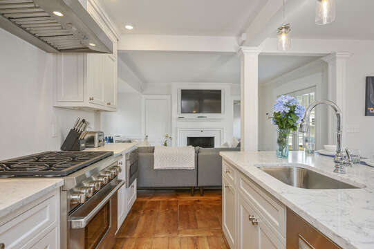 Chefs kitchen with center Island with stainless sink, 6 burner gas range and oven, microwave, open to  living area. 530 Route 28 Harwich Port, Cape Cod, New England Vacation Rentals