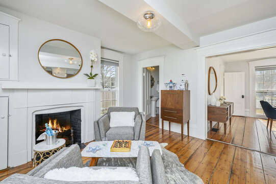 Sitting area with mini bar and 1/2 bath and original fireplace is just off the kitchen. 530 Route 28 Harwich Port, Cape Cod, New England Vacation Rentals