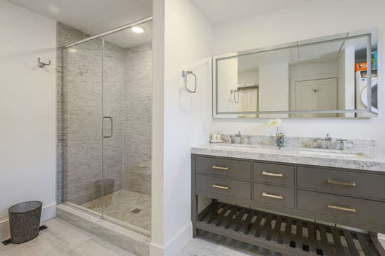 En suite bathroom for bedroom #1 with double vanity and walk in shower. 530 Route 28 Harwich Port, Cape Cod, New England Vacation Rentals