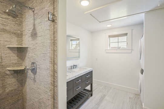 En suite bathroom for bedroom #1 with stackable washer/ dryer. 530 Route 28 Harwich Port, Cape Cod, New England Vacation Rentals