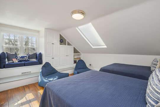 Bedroom #2 with 2 double beds and raised window seat,2 bean bag chairs and skylight, with built-in cabinet and shelves. 530 Route 28 Harwich Port, Cape Cod, New England Vacation Rentals