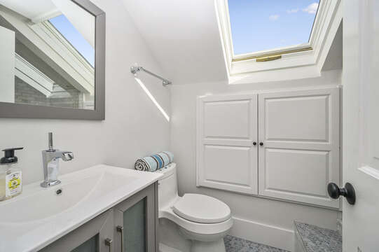 En suite bath to bedroom #2 has vanity and large step shower with skylight and built in cabinets. 530 Route 28 Harwich Port, Cape Cod, New England Vacation Rentals