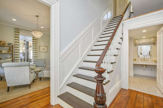 The main staircase is just inside the front door, large half bath. 525 Route 28, Harwich Port, Cape Cod, New England Vacation Rentals