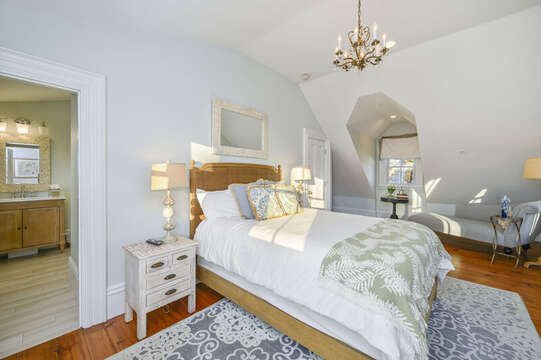The Newport bedroom, a secret room with separate access from the staircase off the kitchen. Queen bed and en suite bath. 525 Route 28, Harwich Port, Cape Cod, New England Vacation Rentals