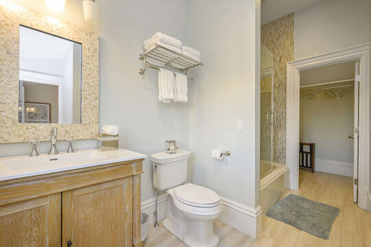 En suite bathroom with large walk in closet for the Nantucket bedroom. 525 Route 28, Harwich Port, Cape Cod, New England Vacation Rentals