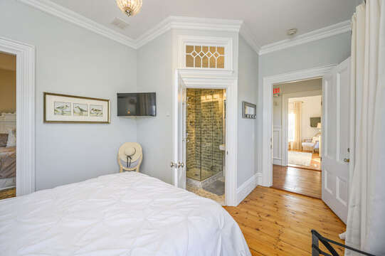 The Key West bedroom, with en suite bath and interior access to the Edgartown bedroom. 525 Route 28, Harwich Port, Cape Cod, New England Vacation Rentals
