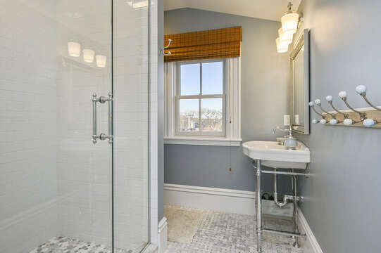 En suite bath with shower for the Harbour Island bedroom. 525 Route 28, Harwich Port, Cape Cod, New England Vacation Rentals