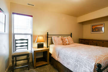 Bedroom 3 with queen bed and nightstand