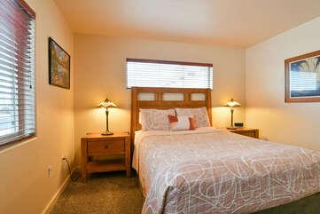 Bedroom 2 with queen bed and nightstands