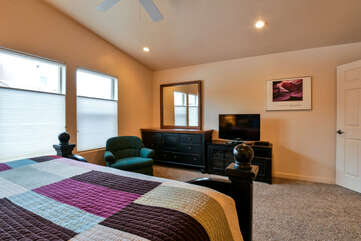 Master Bedroom with TV and chair