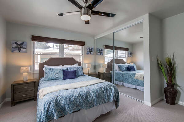 Bedroom Includes Queen Bed and Two Night Stands.