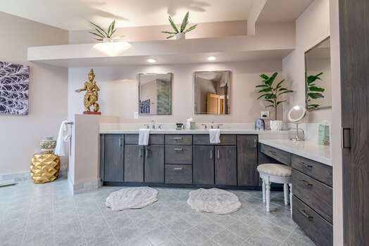 Expansive Master Bath with Dual Stone Counter Sinks and a Makeup Area