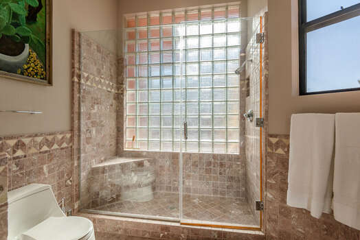 Full Shared Bath with a Tile & Glass Shower
