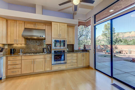 Spacious Kitchen with Patio and Backyard Access