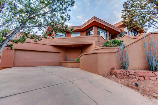 Two-Level 3,335 Sq Ft Home with a Two-Car Garage and Parking in the Driveway