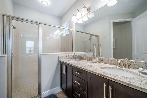Downstairs master bath with dual sink vanity and stand up shower