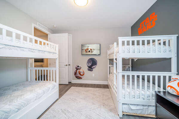 Alternate view of space themed bedroom #3 showing both bunks and the TV