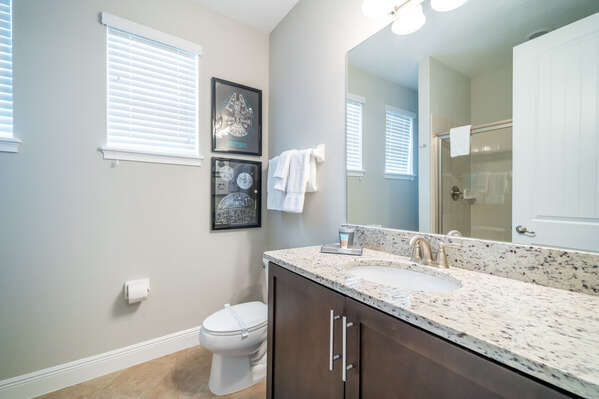 Bathroom #3 with sink sink vanity and shower/tub combo has shared access for loft area