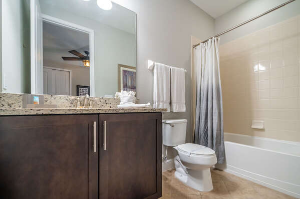 Bathroom 4 with single sink vanity and shower/tub combo