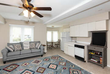 Ground floor bedroom, living space, sleeper sofa with kitchenette and game table.