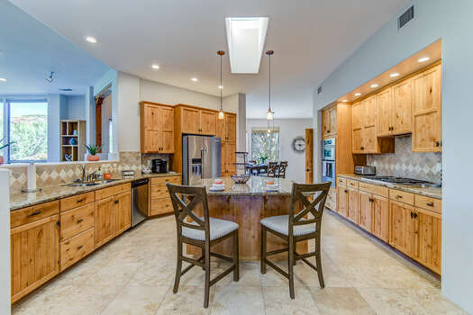 Center Island Seating and Plenty of Granite Counter Space for Meal Prep and Entertaining