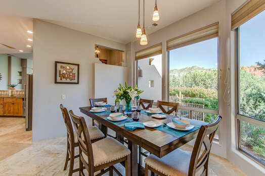Fabulous Dining Space with a Wall of Windows with Those Spectacular Views