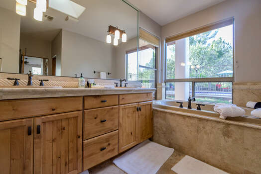 Master Bath with Dual Granite Counter Sinks and Plenty of Natural Light