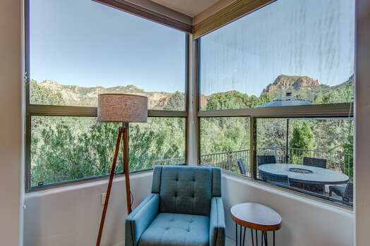 Large Windows with Natural Landscaping and Mountain Views