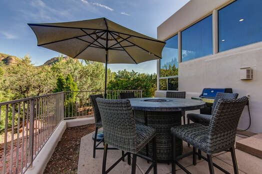 Back Patio with a Fire Dining Table and Natural Gas BBQ