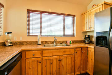 Kitchen with sink and coffee maker