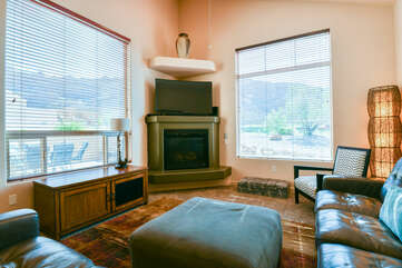 Living room of a Moab rental with fireplace