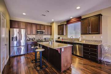 The large kitchen can be stocked with your favorite groceries prior to you arrival