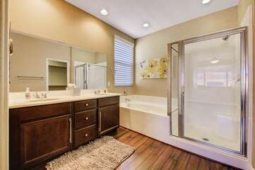 Huge tub and step in shower. Master bath
