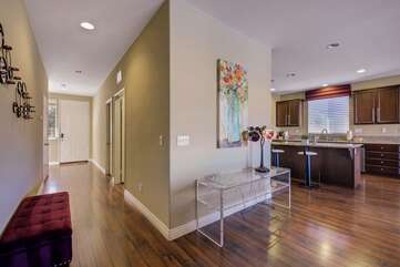 Long entryway leads to the living room & kitchen