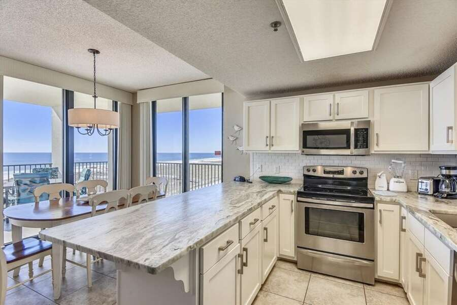 Full Kitchen with Granite Countertops, Stainless Steel Appliances and additional Seating at the Breakfast Bar
