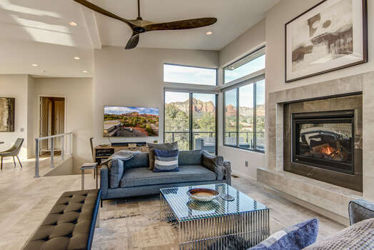 Enjoy the Spacious Living Room with Comfortable, Modern Furnishing, a Cozy Gas Fireplace, and a 65