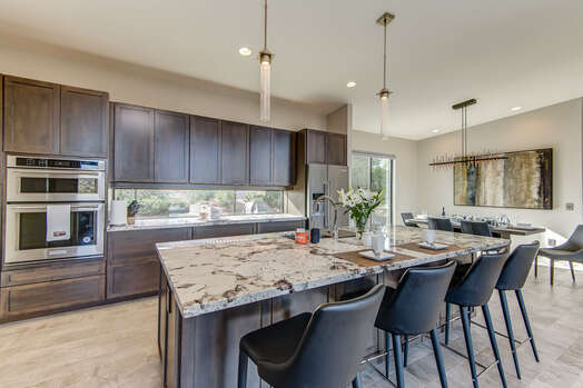 Large Center Island for Meal Prep and Entertaining with Bar Seating for Four