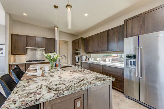 Plenty of Gorgeous Granite Counters and Custom Cabinetry