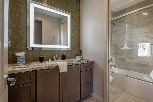 Master Bath 2 with a Granite Counter Vanity and Lighted Mirror, and a Separate Tub/Shower Combo