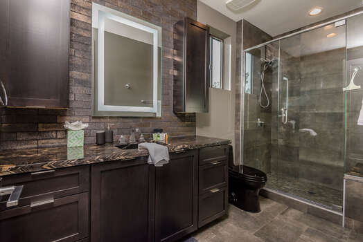 Master (Hall) Bath 3 with a Granite Counter Vanity and Lighted Mirror, and an Oversized Tile/Glass Shower with Dual Shower Heads