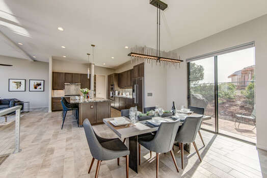 Comfortable and Contemporary Dining Area with a Patio and BBQ
