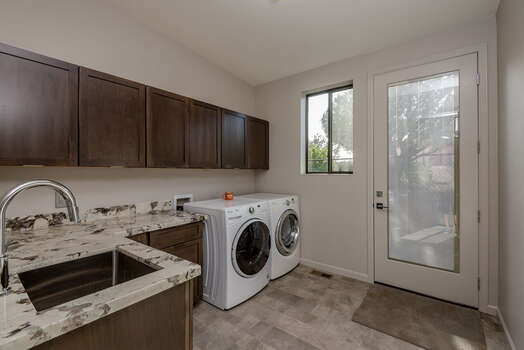 Laundry Room with a Full-size Washer and Dryer, Sink and Exterior Access