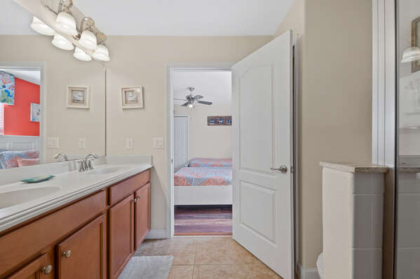 The bathroom has a dual vanity and a large walk-in shower
