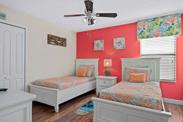 The bright colors will wake you up feeling happy in this bedroom