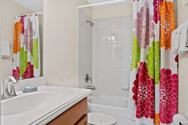 The ensuite has a shower/tub combo