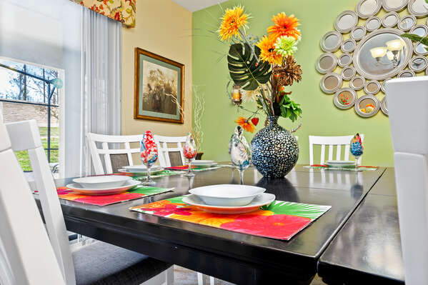 The formal dining table can seat up to 12 guests